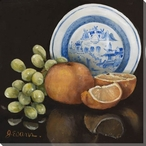 Oranges and Grapes Around a Plate Wrapped Canvas Giclee Print