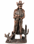Standing Cowboy with Cactus Statue