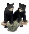Two Black Bear Cubs Sitting on a Tree Branch Sculpture