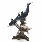 Two Dolphins Swimming with a Turtle Statue