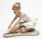 Young Ballerina in White Sitting and Stretching Porcelain Sculpture