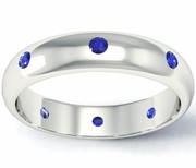 Domed Blue Sapphire Landmark Eternity Band