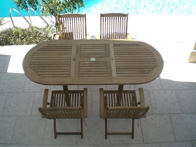 """Teak 60"""" - 78"""" Oval Expansion Table Including 4 Sailor Arm Chairs"""