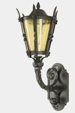 Wrought iron exterior wall sconce with amber glass shade, circa 1920s