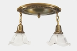 Brass 2-light semi-flush mount ceiling fixture with Holophane glass shades, circa 1910s