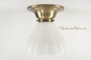 Brass porch ceiling fixture cover with white glass shade, circa 1910s