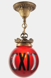 Cast brass red glass pendant exit light, circa 1910s