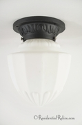Cast iron porch ceiling fixture cover with white matte glass globe, circa 1910s