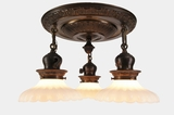 Embossed brass 3-light semi-flush mount chandelier with opalescent glass shades, circa 1910s