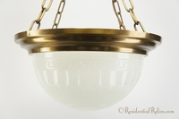 Four chain brass chandelier with cast-glass inverted dome, circa 1910s