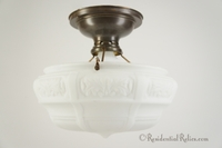 Brass ceiling fixture with embossed satin glass shade, circa 1910s