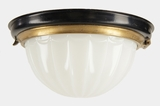Cast brass and black enameled steel ceiling fixture with inverted glass dome, circa 1920s