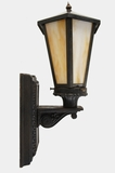 Cast iron exterior wall sconce with 6-panel slag glass shade, circa 1910s