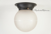Cast iron porch ceiling fixture cover with cut glass globe, circa 1910s