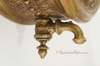 Embossed brass lavabo reservoir with cast brass spigot, circa 1900