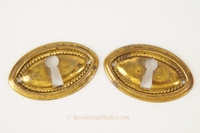Oval brass keyhole cover, circa 1910s (2 available)