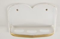 Porcelain toothbrush holder with gilt trim, circa 1910s