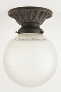 Large star cut globe on cast iron ceiling fixture, circa 1910s