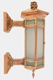 Monumental copper and brass exterior wall sconce, circa 1910s
