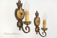 Pair polychrome cast and wrought iron single-candle wall sconces, circa 1910s
