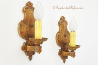 "PAIR ""Champion"" cast iron polychrome wall sconces, circa 1920s"