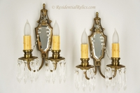 PAIR 2-candle brass, beveled mirror and crystal wall sconces, circa 1920s