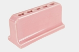 Pink ceramic freestanding toothbrush holder, circa 1930s