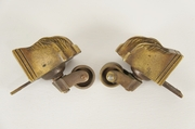 SET of 4 heavy cast brass feathered paw casters with pivoting wheels, circa 1910s