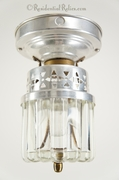 Mid-century aluminum ceiling fixture with thick glass globe, circa 1950s