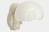 Paulding porcelain bath sconce with hooded glass shade, circa 1930s