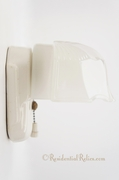Porcelain bath sconce with hooded glass shade, circa 1930s