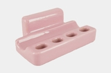 Pink ceramic toothbrush and toothpaste holder, circa 1950s