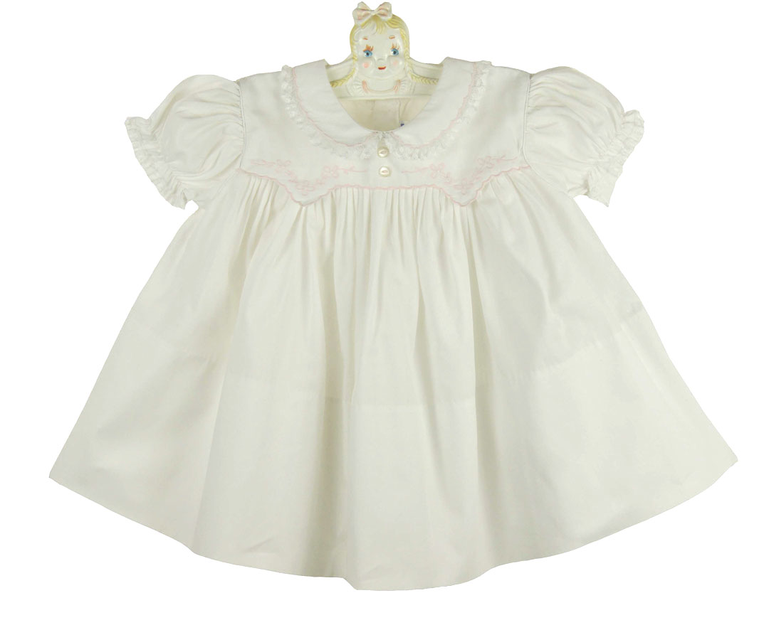 Feltman Brothers white baby dress with pink embroidery