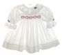 "<img src=""https://p11.secure.hostingprod.com/@grammies-attic.com/ssl/images/blue-sold-1.gif"">Polly Flinders White Smocked Baby Dress with Lace Trim and Red Rosebud Embroidery"