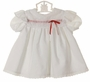 Polly Flinders White Eyelet Trimmed Dress with Red Ribbon Insertion
