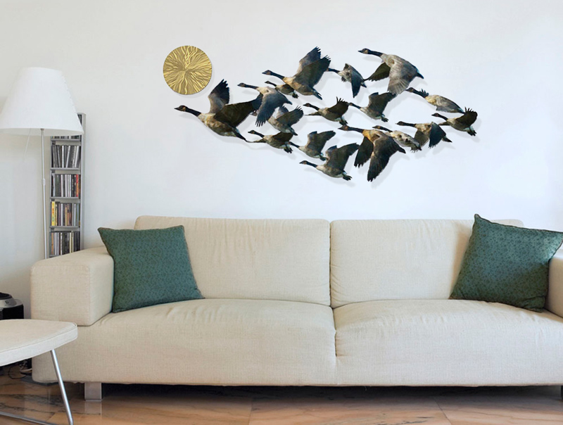 Metal geese in flight wall decor