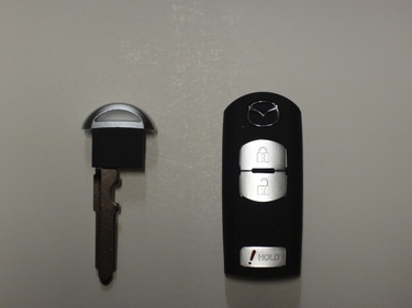 Genuine Mazda CX-5 Remote Transmitter and key (key not cut and not programmed to start your CX-5)