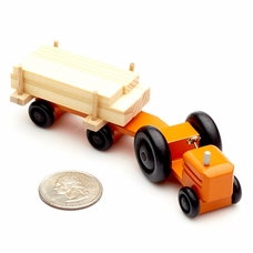 Orange Farm Tractor With Wood Trailer - Dregeno Seiffen