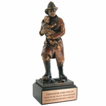 11-1/2 INCH FIREFIGHTER WITH CHILD TROPHY, ELECTROPLATED IN BRONZE
