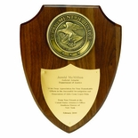 9-1/2 X 12 INCH GENUINE WALNUT SHIELD, WITH 4 INCH HIGH RELIEF MEDALLION
