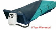 LOW AIR LOSS MATTRESS AND PUMP WITH RAISED EDGES