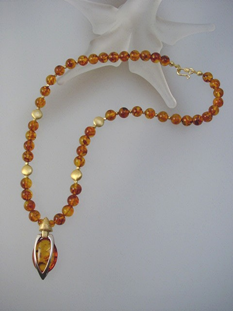 Stylish baltic amber necklace with unique handcrafted pendant baltic amber sterling silver jewelry unique honey amber necklace aloadofball Images