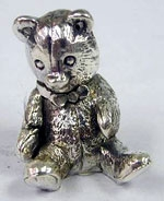 silver teddy bear figurine