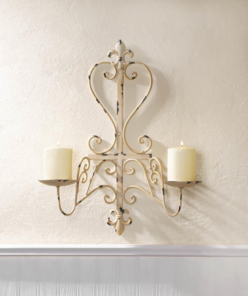 Antiqued fleur de lis candle sconce wholesale at koehler for Fleur de lis home decorations