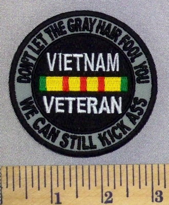 2494 CP - Don't Let The Gray Hair Fool You - We Can Still Kick Ass - Gray Background - Round - Vietnam Veteran - Embroidery Patch