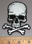 4040 G - Reflective - Skull Face With Cross Bones - Embroidery Patch