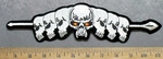 5316 S - 7 Skull Heads On Spear - Red- Yellow Eyes - Embroidery Patch