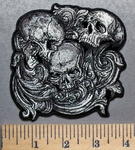 5698 G - Triple Skulls Within Gowing Vine - Embroidery Patch