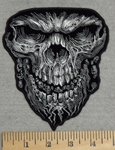 2852 G - Evil Skull Face With Weblike Beard And Bones In Mouth - Embroidery Patch