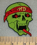 2466 N - Green Skull With Red HD Bandana With Red Eyes And Tongue - Embroidery Patch